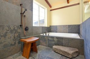 Classic-Japanese-bath-with-simple-teak-stool-and-daft-use-of-stone